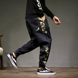 Men trousers size 36 black online shopping - Autumn and winter Harlan jeans male elastic loose large size fat hip hop black camouflage feet wide leg trousers