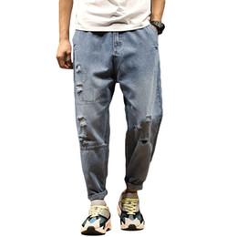 Vente en gros Trou de printemps d'été hommes taille élastique lâche déchiré Jeans mince longueur cheville Denim pantalons loisirs Joggers Pantalons pour hommes