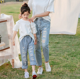 6e2c8d7160d Mommy and daughter matching outfits fashion kids hole jeans girls double  pocket elastic denim pants children casual cowboy trouser F7410