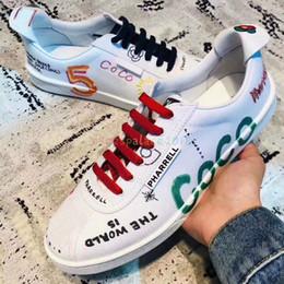 247c7840122e Scarpe da ginnastica di design casual per l'estate Scarpe di tela nuove  bianche Scarpe da donna per uomo Graffiti CoCo Joint Uomo Scarpe casual  Sport ...
