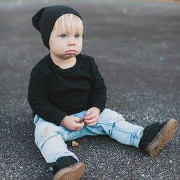 Sombrero de punto de algodón salvaje negro, rojo, marrón y otros colores de primavera y otoño para niños unisex en venta