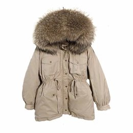 duck tie NZ - Female Sash Tie Up Warm Snow Outwear White Duck Down Coat Women Winter Jackets Large Natural Raccoon Fur Hooded Down Parka MX191025