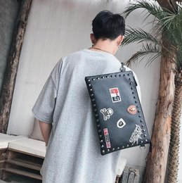 $enCountryForm.capitalKeyWord Australia - Original design medal decoration fashion hand bag street personality rivet men Hand Shoulder Bag Punk medal leather shoulder bag