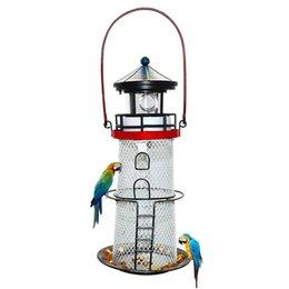 Faro solare, mangiatoia per uccelli in metallo, faro girevole leggero, decorazione di arte del giardino, appendere la luce, appendere la luce, portatile, faro in Offerta