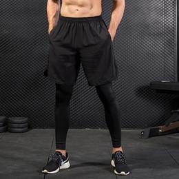 Men Wearing Leggings Australia - New False Two Compression Tights Men's Leggings Fitness Exercises men pants joggers long pants men Bodybuilding gyms wear