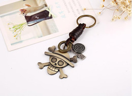 Cowhide Pieces Australia - Hot Anime One Piece Keychain Metal Pirates Skull Pendant Keyring For Teenager Men Cowhide Leather Key Chain