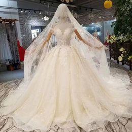 f5773c1dfd Vestidos de novia de novia Da un velo con un gorro de cristal Fuera del  hombro Vestidos de novia de espalda 2019 Lo más nuevo Vestido de fiesta  Vestido de ...