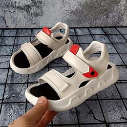 2222ce9b8c7d9 kid sandals 2019 Korean boys Genuine leather soft bottom Casual Flats  designer sandals Children non-slip girls casual beach shoes