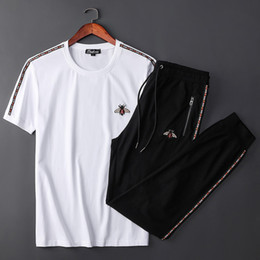 men short suit set UK - Motion Suit Male Short Sleeve Trousers Thin Money Small Bee Leisure Time Athletic Wear Young Man Two Piece Set