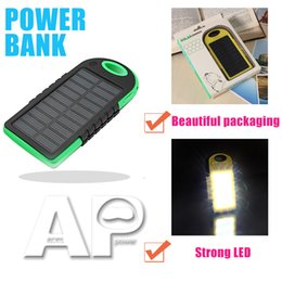 Discount cell phone external battery banks - Universal Portable Solar Charger power bank waterproof battery charger with LED flashlight external Portable charger for