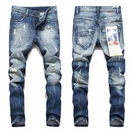 25f8da1726 Nuevos Pantalones vaqueros para hombre Robin Motociclista pantalones  vaqueros del motorista Renacimiento de la piel Skinny Slim Ripped hole  Hombres Famous ...