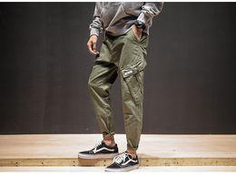 New fashioN koreaN meN s online shopping - New Korean Harem Pants Men Multi Pockets Design Cargo Pants Mid Waist Men s Hot Sale Army Trousers Overalls Casual Pencil Pants XL