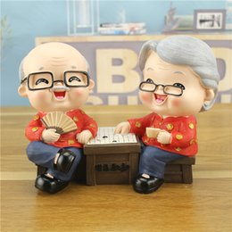 $enCountryForm.capitalKeyWord Australia - very auspicious at home! Wedding gifts Furniture old man woman save money can live wedding decoration couples resin crafts statue home