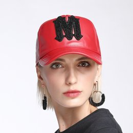 7de34ca9d68 New Spring Women American Pearl Rivet Shiny M Word Genuine Leather Baseball  Caps Men Hipsters Hip Hop Caps Male Black Red Hats