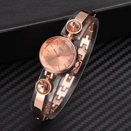 $enCountryForm.capitalKeyWord NZ - Disu Brand Women Watches Rose Gold Bracelet Watch Ladies Unique Design Round Rhinestone Quartz Dress Watches Reloj Mujer