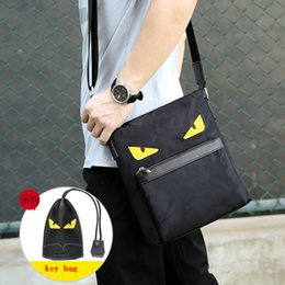 c8173f564a Free shipping luxury brand Monster Eyes Handbags Fashion Oxford cloth  Shoulder Bag Men woman Designer High Quality Crossbody Bags free shipp