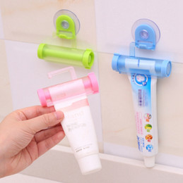tube squeezers plastic NZ - Toothpaste Dispenser Plastic Rolling Tube Squeezer Manual Syringe Gun Dispenser Sucker Holder Dental Cream Bathroom Accessories YW1864