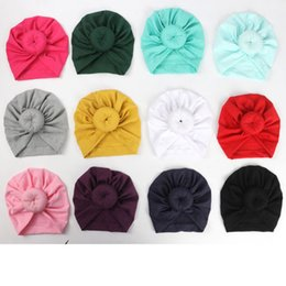 $enCountryForm.capitalKeyWord NZ - Baby Newborn Baby Kid Girl Infant Toddler Bowknot Beanie Cute Hat Hospital Cap Comfy Knotted Headwear Headband 12 colors