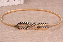 4f90e302a Hot Women Belt Leaf Design Clasp Front Stretch Alloy Metal Waist Belt  Skinny Elastic Leaves Dress Cummerbund Gold Silver Waistband