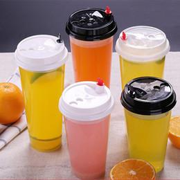 700ml 24 oz Vasos de plástico desechables Bebidas calientes frías Jugo Café Taza de té lechosa Espesar Herramienta de bebida transparente con tapa en venta