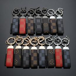 $enCountryForm.capitalKeyWord Australia - Leather Glod Silver Black Luxury Designer Key chains Steel Peugeot GMC VW Benz Audi Volvo Key rings High quality