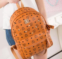 $enCountryForm.capitalKeyWord Australia - Wholesale Punk style Rivet Backpack Fashion Men Women Cheap Knapsack Korean Stylish Shoulder Bag Brand Designer Bag High-end PU School Bag