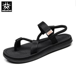 Brown Summer Sandals Canada - URBANFIND New Man Beach Water Shoes Black Brown Size 39-45 Designer Men Casual Summer Sandals Breathable Light Slip-on Shoes