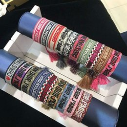 $enCountryForm.capitalKeyWord Australia - Luxury Style Rope Material Woven Bracelet With Sewing Words And Tassel Hand Strap Famous Brand Jewelry For Women Gift