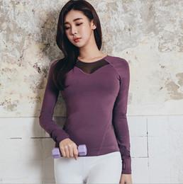 687d83c59 Calças de fitness das mulheres novas de outono e inverno de manga comprida  yoga roupas t-shirt temperamento luta net fitness running shirt