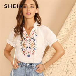 3710ed1ba6 Lady Tie Neck Puff Sleeve Flower Embroidered Blouse Ruffle Trim Women White  Blouse Summer Shirts Blouses C19041001