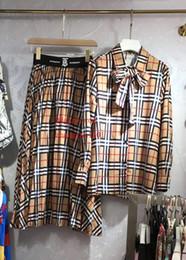 Linen Dress Suit Australia - 2019 summer dress women Tracksuit Trendy plaid printed bow shirt+wild long skirt woman 2pcs suit High quality women clothes BC-2