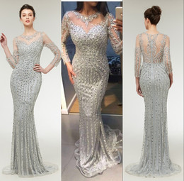 sparkly evening dresses sleeves NZ - 2019 Sparkly Sliver Sequins Crystal Prom Dresses Illusion Jewel Neck Long Sleeves Major Beading Sweep Train Mermaid Party Evening Gowns Wear