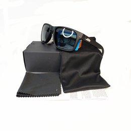 Marca de moda polarizada Gafas de sol del deporte al aire Gafas de sol Hombres Mujeres Googles Ciclismo Gafas de sol 9102 de la alta calidad Nueva caja de embalaje en venta
