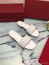 black weaves Canada - Lady new summer slippers, woven leather shoes, flat sandals, black and white with fashionable open toe slippers With box 35-40