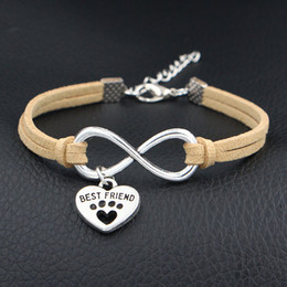 dog chain bracelet Canada - Infinity Pets Dog Paw Best Friend Cuff Bracelet Unique Beige Leather Wrap Bangles Wholesale Handmade Bohemian Weaving Jewelry Dropshipping