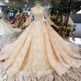 $enCountryForm.capitalKeyWord Australia - Lace Queens Wedding Dresses Champagne Elegant High Neck Crystal Beaded Illusion Long Sleeves Ball Gown Wedding Gowns With Long Train Muslim