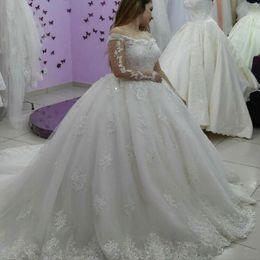 Ingrosso Abiti da sposa arabi con maniche lunghe con maniche a palloncino Dubai 2019 Applicazioni di spalline con applicazioni di paillettes