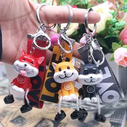 $enCountryForm.capitalKeyWord Australia - New Korean version of puppy ribbon key buckle cute suspender pendant student key buckle wholesale, creative gifts free of freight