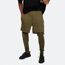 China Mens Jogger Pants Shorts Leggings Panalled Skinny Jogging Pants 2 Colors Solid Running Gym Sweatpants Free Shipping supplier jog men shorts suppliers