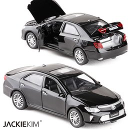 toyota toy car models NZ - New 1:32 Scale TOYOTA CAMRY Metal Alloy Diecast Car Model Miniature Model With Pull Back Sound Light Model For Children Car Toys SH190910