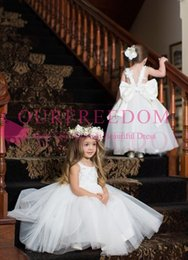 Covered baCk wedding dress line online shopping - 2020 Cheap White Spaghetti Straps Flower Girls Dresses Back Cover Bow Lace Appliques First Communion Dresses Girls Pageant Gown Custom Made