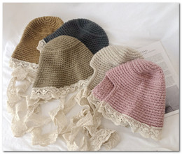 winter bow hats Australia - Fall winter new Kids crochet hat girls lace hollow floral embroidery falbala princess hat children lace lace-up Bows knitted beanie J0894