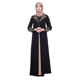 China Muslim Elegant Dress Women Abaya Dubai Kaftan Muslim Flowers Hot Stamping Dress Long Sleeve Loose Islamic Female Clothin supplier dress stamps suppliers