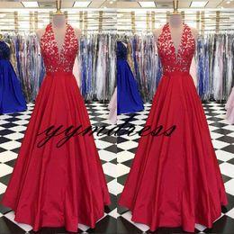 Nude Red Lining Dress Australia - Red Evening Dresses 2019 New Dubai Arabic Prom Gowns Appliqued Lace Sexy A-line Party Dress Halter V-Neck Backless Vestido De Festa