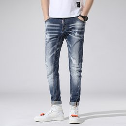 2193a228bb0 Blue Stretch Jeans Brand Slim Fit Men Washed Painted Zipper Hip Hop Hole  close-fitting Denim pants Straight Trousers 1piece AAA1955