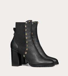 sexy black women booty NZ - Top quality Brand Bottines Rock Studs Women Sexy Ankle Boots Black Calf Leather Lady Winter Fashion Booty Perfect Party Wedding