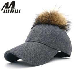 Minhui 2016 New Fashion Pompom Hat Women Baseball Caps Real Racoon Fur Pom  Poms Hats for Women Visor Casquette Hats Female Cap  220161 abd96278695