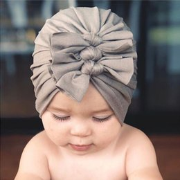 baby skull fabric Australia - 18 Colors New Kids Cotton Hat Autumn Winter Newborn Baby Soft-knitted Fabric Bowtie Cap Beanie Cap Infant Turban Hats baby Headband