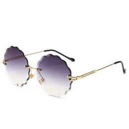 827f9769a60ad2 Frauen Blume Geformte Sonnenbrille Mode Randlose Brillen Damen  Persönlichkeit Mode Metall Sonnenbrille Retro Ozean Farbige Brille LJJR193