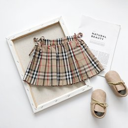Girls ruffled tutu skirts online shopping - Retail kids luxury designer clothes girls bow plaid skirts Classic preppy princess dress pleated skirt Children boutique clothing off